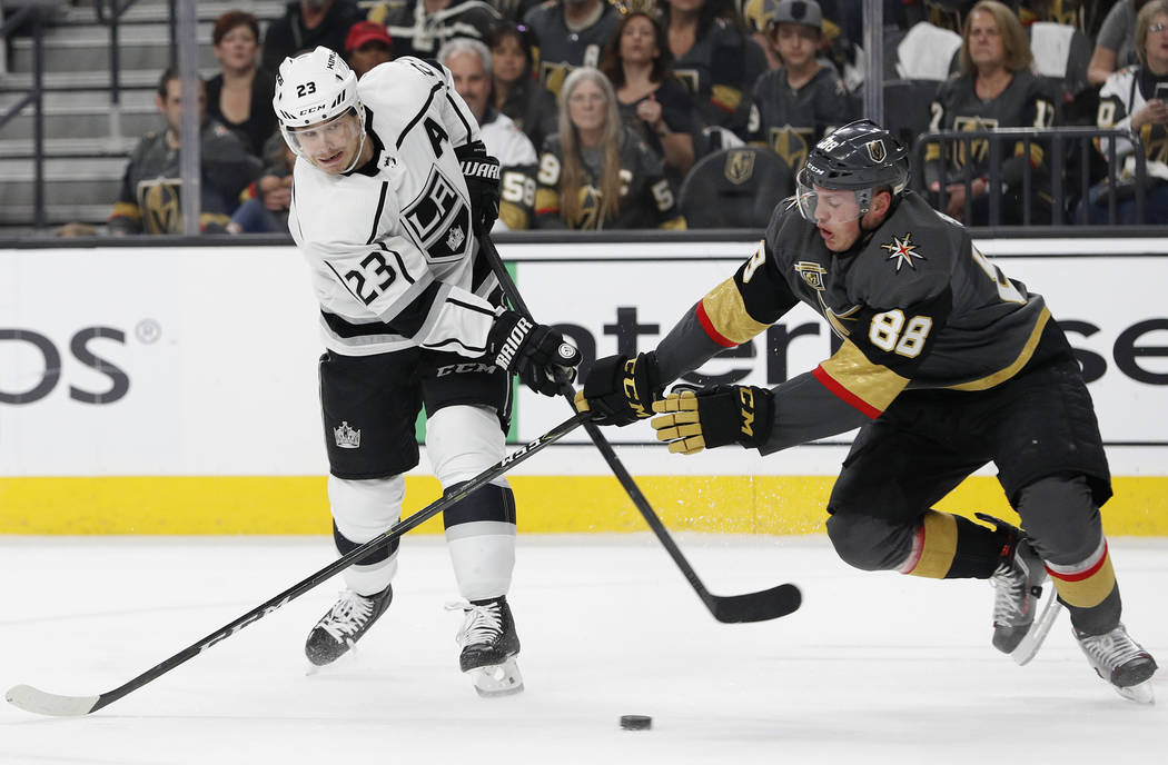 Los Angeles Kings right wing Dustin Brown (23) shoots against Vegas Golden Knights defenseman Nate Schmidt (88) during the first period of Game 2 of an NHL hockey first-round playoff series, Frida ...