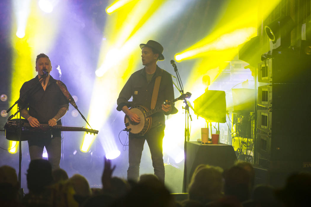 Andy Hall, left, and Chris Pandolfi of The Infamous Stringdusters perform during the first night of the Bender Jamboree music festival at the Plaza in downtown Las Vegas on Thursday, April 12, 201 ...