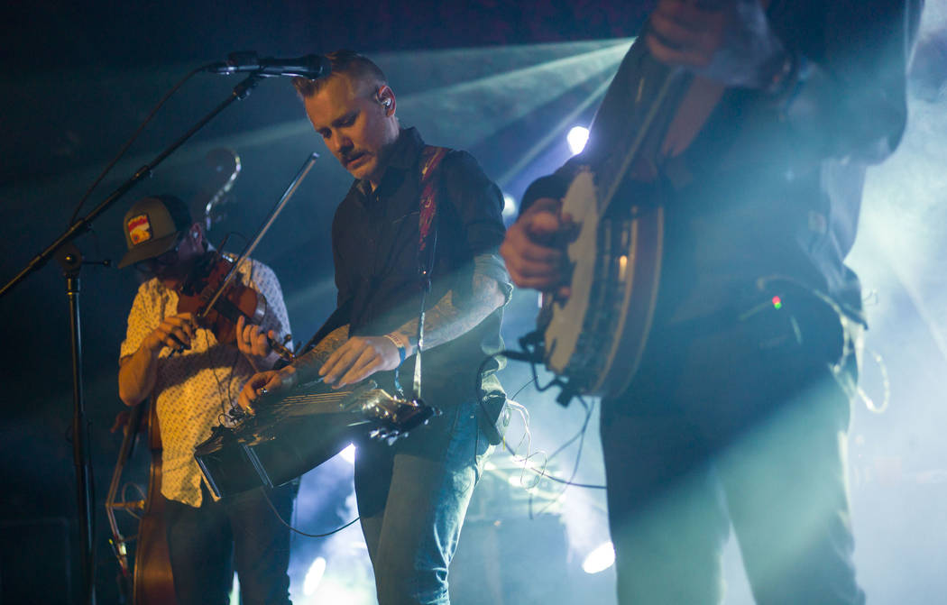 Jeremy Garrett, left, and Andy Hall, center, of The Infamous Stringdusters perform during the first night of the Bender Jamboree music festival at the Plaza in downtown Las Vegas on Thursday, Apri ...