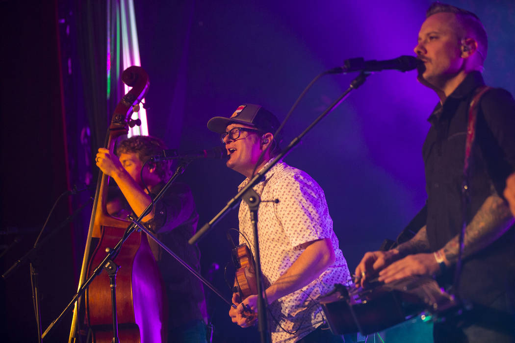 Jeremy Garrett, center, and Andy Hall, right, of The Infamous Stringdusters perform during the first night of the Bender Jamboree music festival at the Plaza in downtown Las Vegas on Thursday, Apr ...