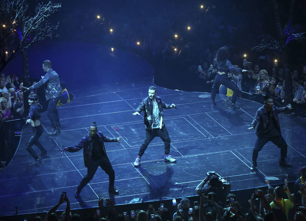 Justin Timberlake, center, performs at T-Mobile Arena in Las Vegas on Saturday, April 14, 2018. Chase Stevens Las Vegas Review-Journal @csstevensphoto