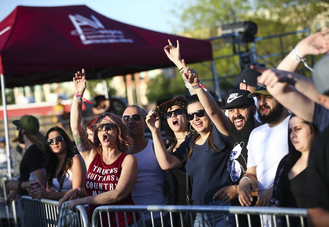 Attendees listen as Mitchell Tenpenny performs during the ACM Party for a Cause at Stoney's Rockin' Country in Las Vegas on Friday, April 13, 2018. Chase Stevens Las Vegas Review-Journal @cssteven ...
