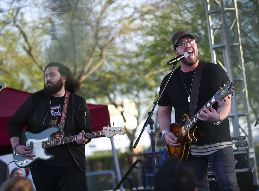 Mitchell Tenpenny, right, performs during the ACM Party for a Cause at Stoney's Rockin' Country in Las Vegas on Friday, April 13, 2018. Chase Stevens Las Vegas Review-Journal @csstevensphoto