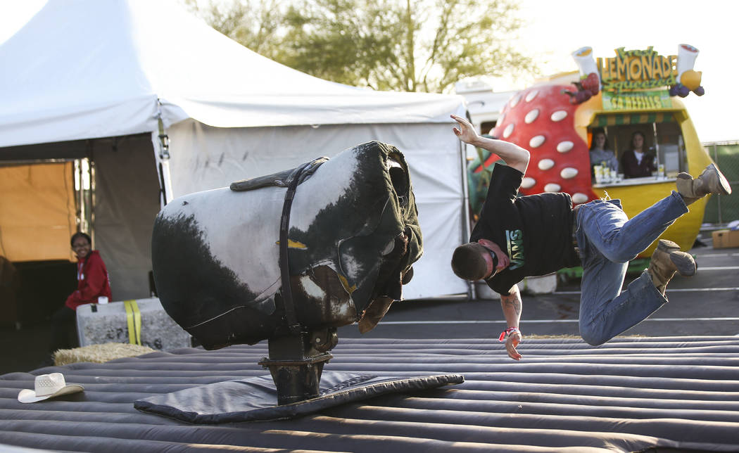 An attendee gets bucked off of a mechanical bull during the ACM Party for a Cause at Stoney's Rockin' Country in Las Vegas on Friday, April 13, 2018. Chase Stevens Las Vegas Review-Journal @csstev ...