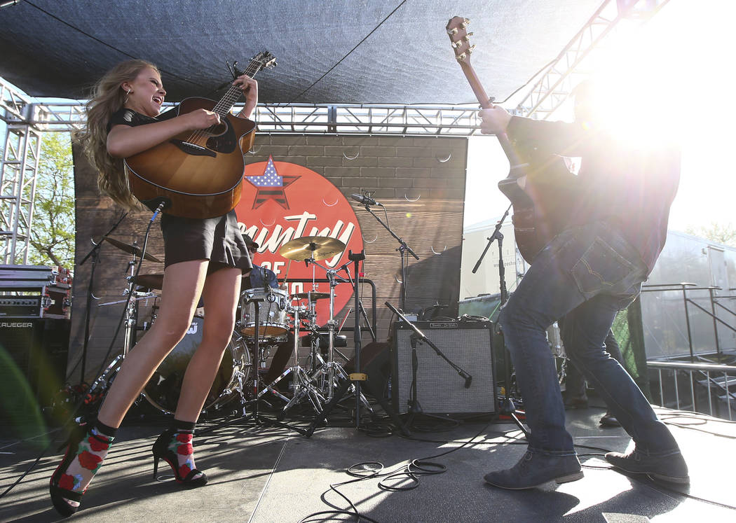 Tegan Marie, left, performs during the ACM Party for a Cause at Stoney's Rockin' Country in Las Vegas on Friday, April 13, 2018. Chase Stevens Las Vegas Review-Journal @csstevensphoto
