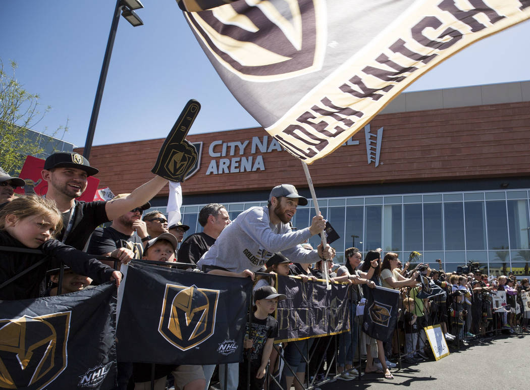 A Golden Knights fan waives the team flag outside City National Arena during a send-off event ahead of games three and four of the NHL playoff series against Los Angeles Kings on Saturday, April 1 ...