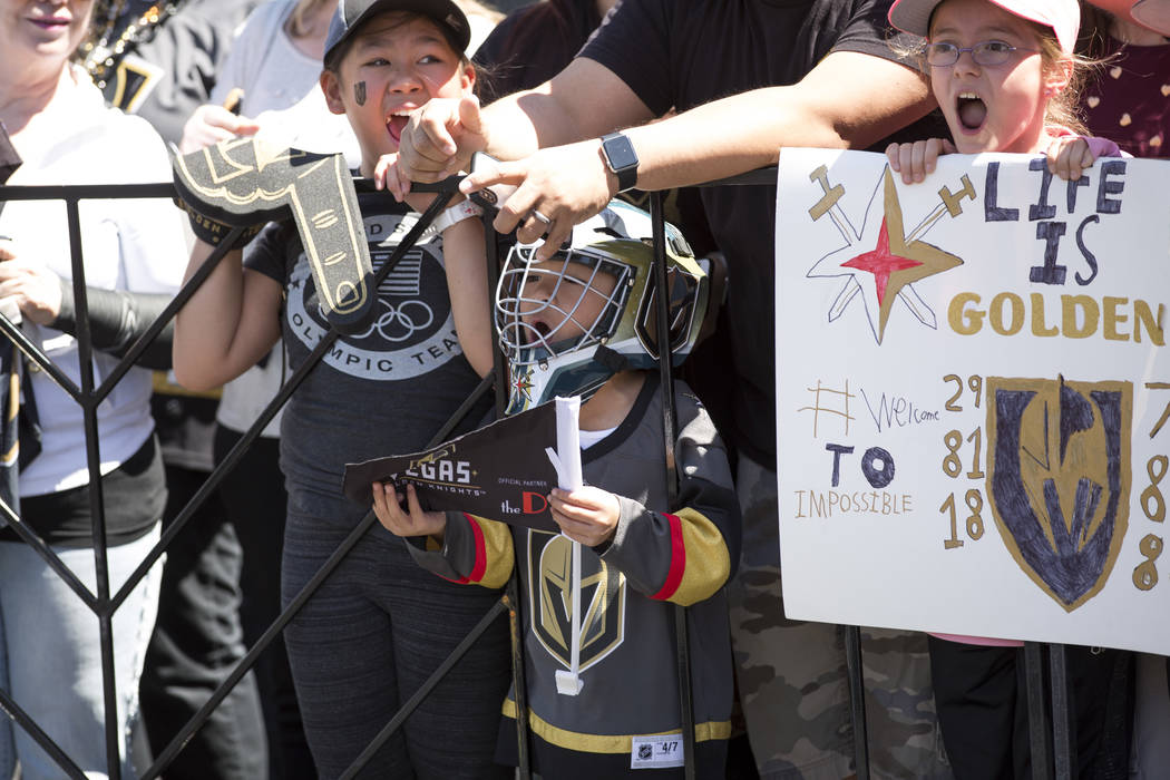 Young Golden Knights scream wait for passing players outside City National Arena during a send-off event ahead of games three and four of the NHL playoff series against Los Angeles Kings on Saturd ...