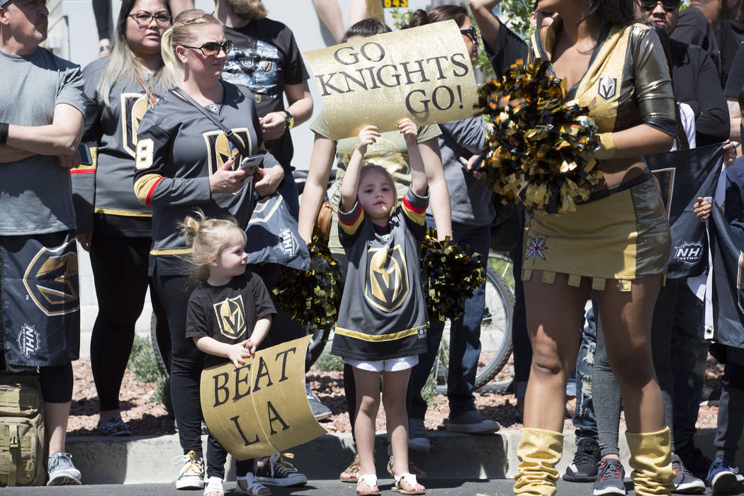 Young Golden Knights fans hold up signs as they wait for passing players outside City National Arena during a send-off event ahead of games three and four of the NHL playoff series against Los Ang ...