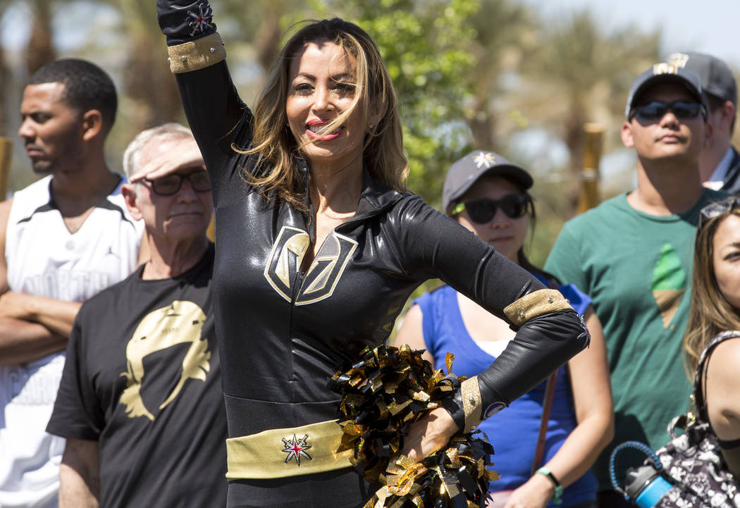 A member of the Knights Crew performs for fans outside City National Arena during a send-off event ahead of games three and four of the NHL playoff series against Los Angeles Kings on Saturday, Ap ...