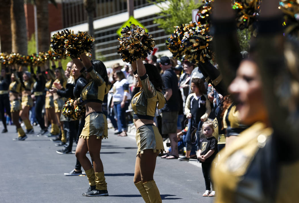 Members of the Knights Crew perform for fans outside City National Arena during a send-off event ahead of games three and four of the NHL playoff series against Los Angeles Kings on Saturday, Apri ...