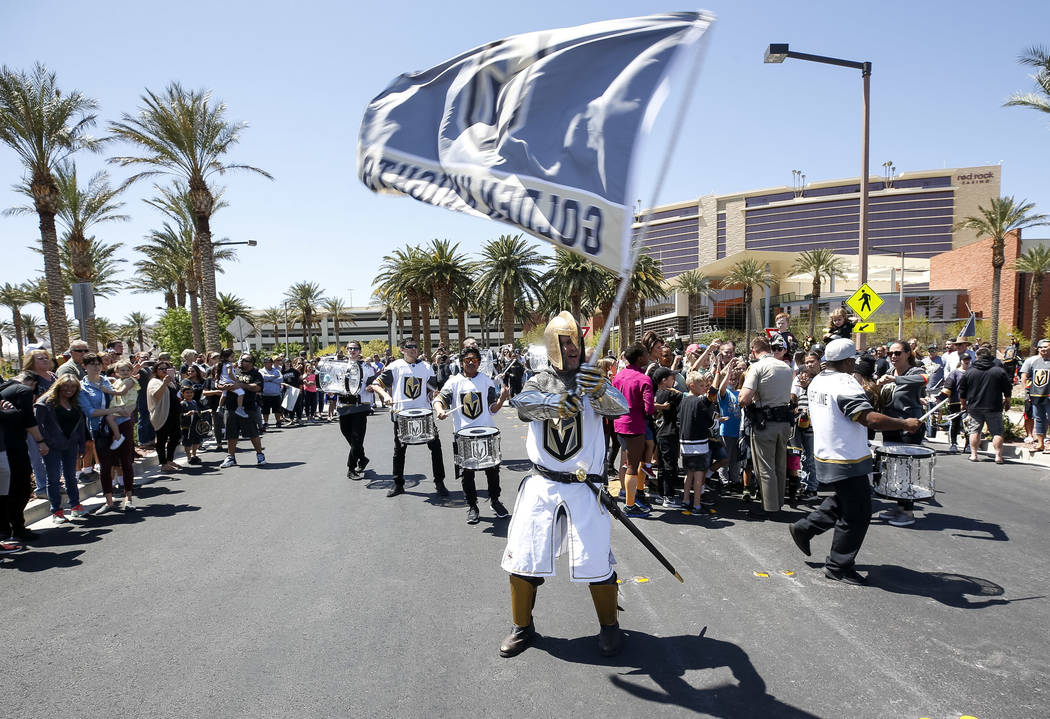 The Golden Knight waives the team flag outside City National Arena during a send-off event ahead of games three and four of the NHL playoff series against Los Angeles Kings on Saturday, April 14, ...