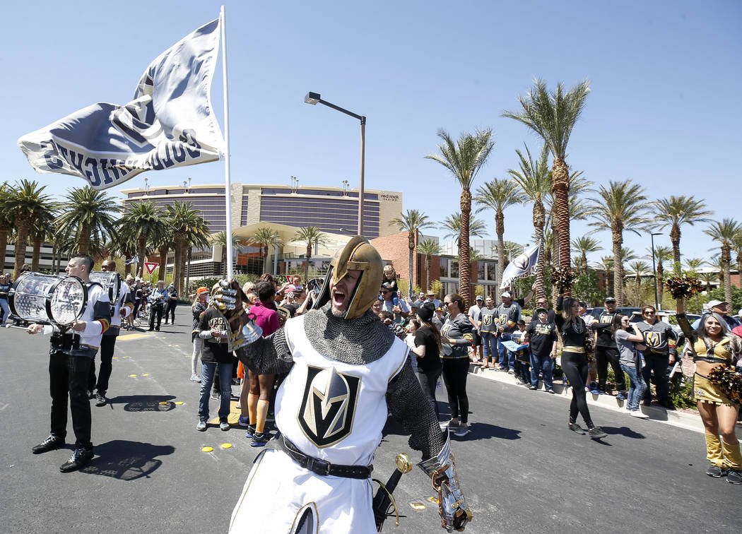 The Golden Knight waive the team flag outside City National Arena during a send-off event ahead of games three and four of the NHL playoff series against Los Angeles Kings on Saturday, April 14, 2 ...