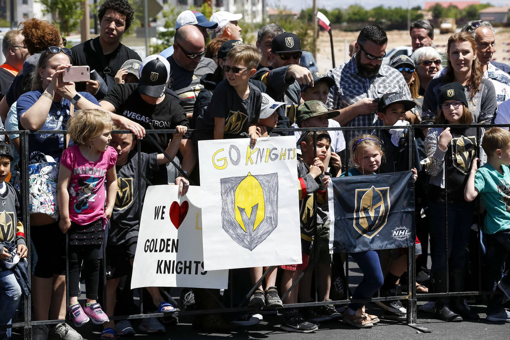 Golden Knights fans wait for passing players outside City National Arena during a send-off event ahead of games three and four of the NHL playoff series against Los Angeles Kings on Saturday, Apri ...