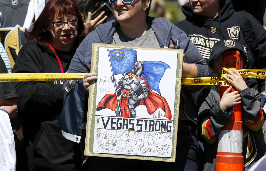 A Golden Knights fan holds up a sign outside City National Arena during a send-off event ahead of games three and four of the NHL playoff series against Los Angeles Kings on Saturday, April 14, 20 ...
