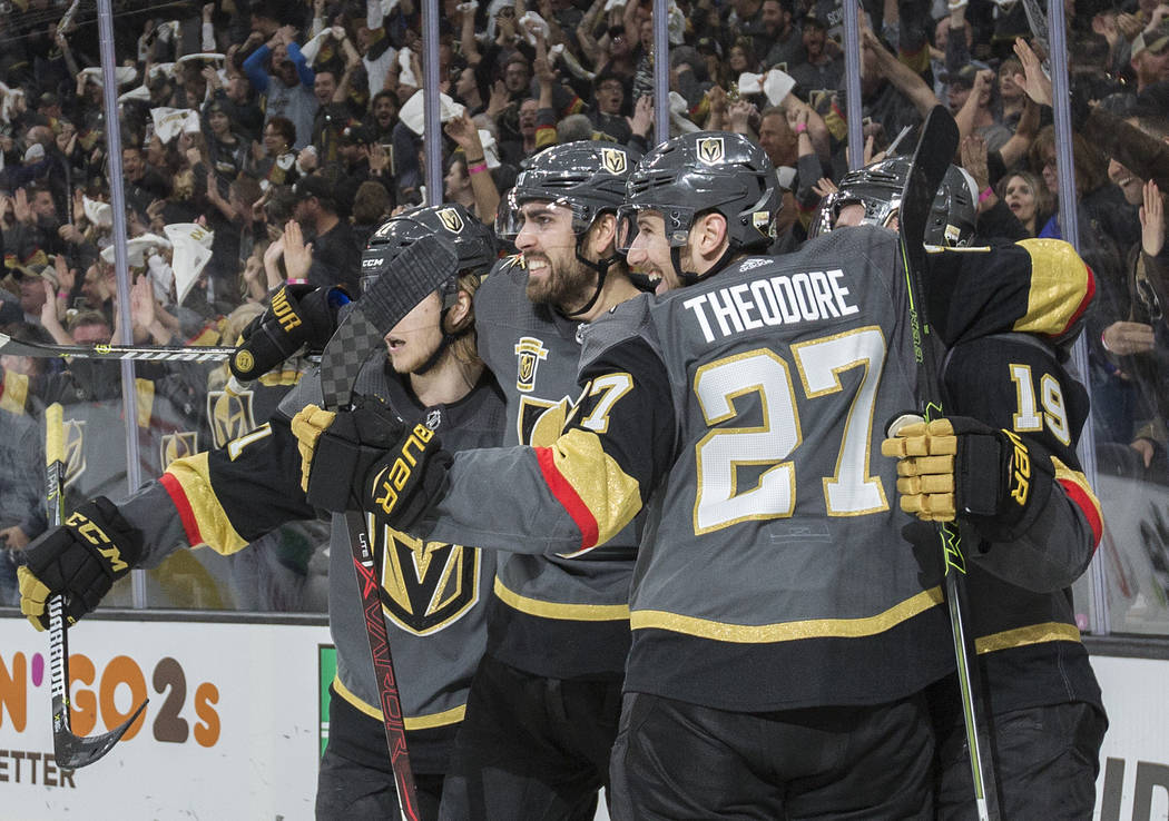 Golden Knights right wing Alex Tuch (89), second from left, celebrates with teammates after scoring a first-period goal during Vegas' game two playoff matchup with Los Angeles on Friday, April 13, ...