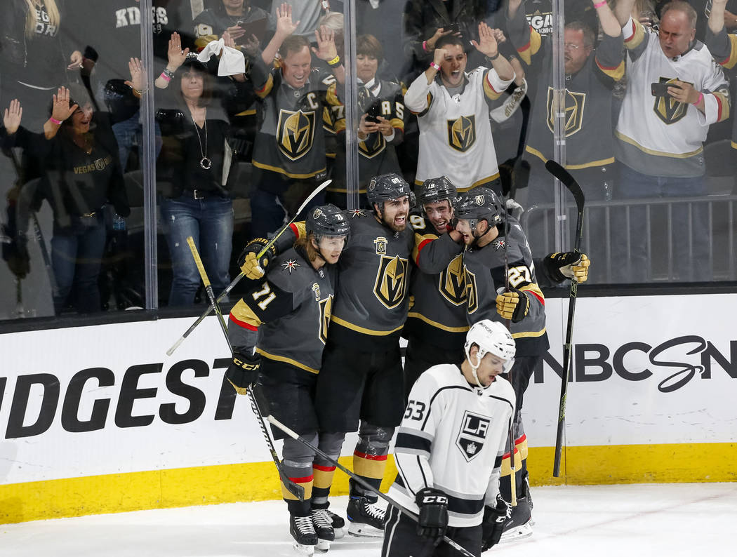 The Vegas Golden Knights celebrate a first period goal by Knights right wing Alex Tuch (89), second from left, in Game 2 of an NHL hockey first-round playoff series between the Golden Knights and ...