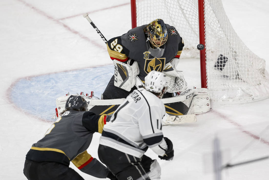 Golden Knights goaltender Marc-Andre Fleury (29) blocks a shot from Los Angeles Kings center Anze Kopitar (11) during the third period of Game 2 of an NHL hockey first-round playoff series between ...