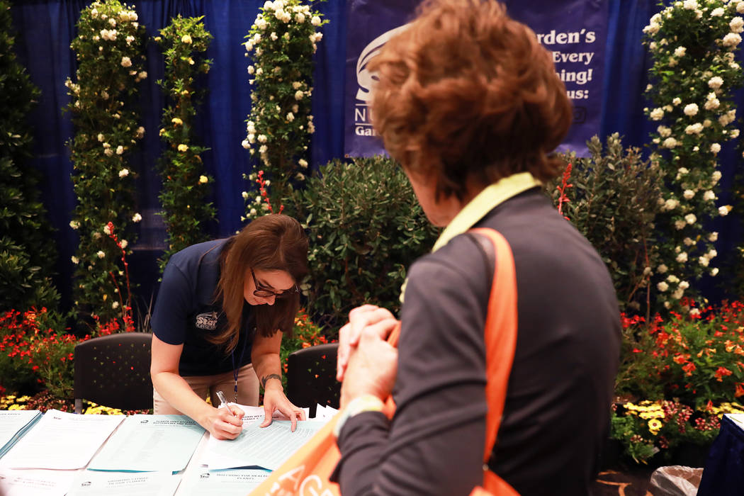 Crystal Gwaltney, of Star Nursery, tends to customers during the AgeWell Expo at the Rio Convention Center in Las Vegas on Saturday, April 14, 2018. Andrea Cornejo Las Vegas Review-Journal @dreaco ...