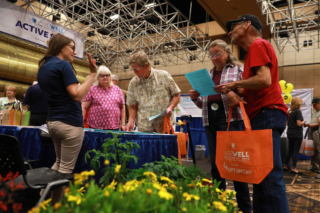 Attendees look at information about Star Nursery during the AgeWell Expo at the Rio Convention Center in Las Vegas on Saturday, April 14, 2018. Andrea Cornejo Las Vegas Review-Journal @dreacornejo