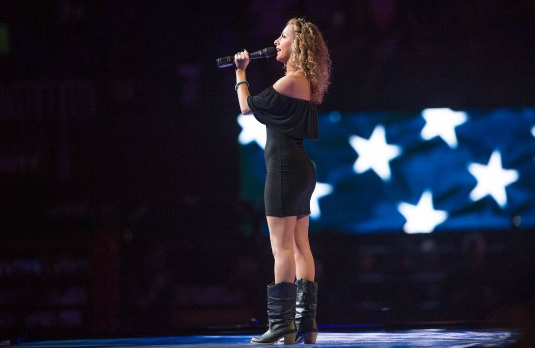 Lorena Peril performs the national anthem during Night 1 of the five-day 2016 Built Ford Tough Professional Bull Riders World Finals at T-Mobile Arena on Wednesday, Nov. 2, 2016, in Las Vegas. (To ...