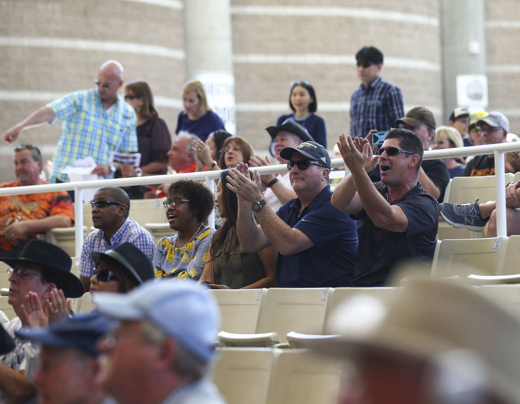 Attendees applaud as 15-year-old guitarist Brandon Niederauer performs during Henderson Bluesfest at Henderson Pavilion on Saturday, April 14, 2018. Niederauer, who starred in the School of Rock t ...