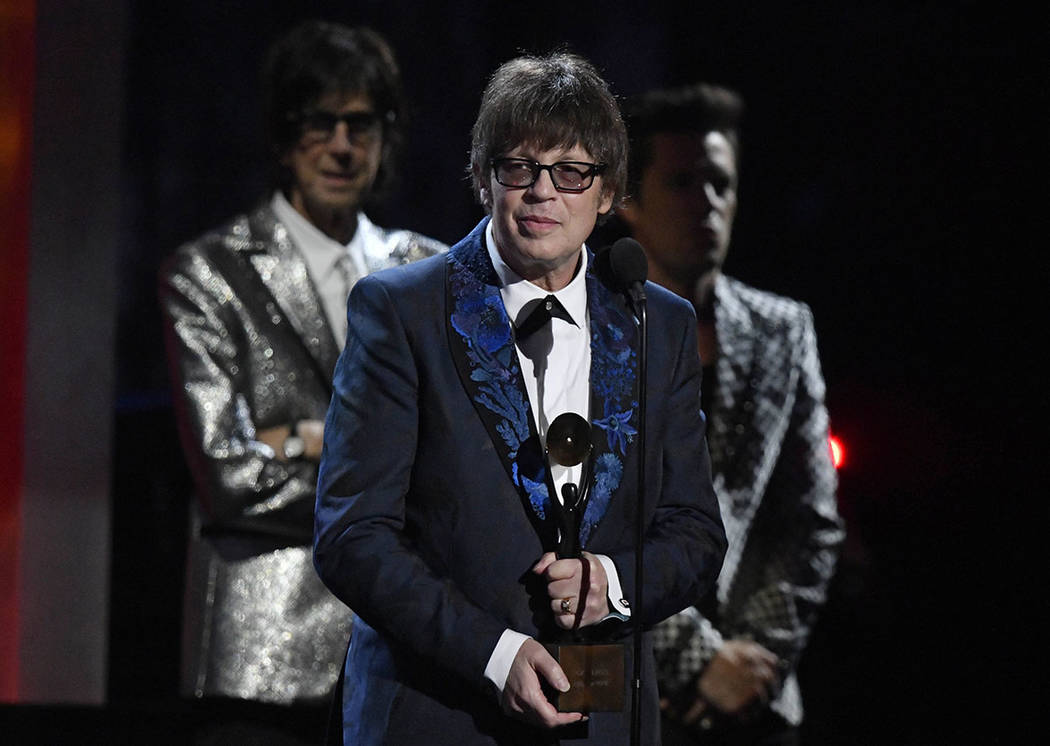 Elliot Easton of the Cars speaks during the Rock and Roll Hall of Fame induction ceremony, Saturday, April 14, 2018, in Cleveland. (AP Photo/David Richard)