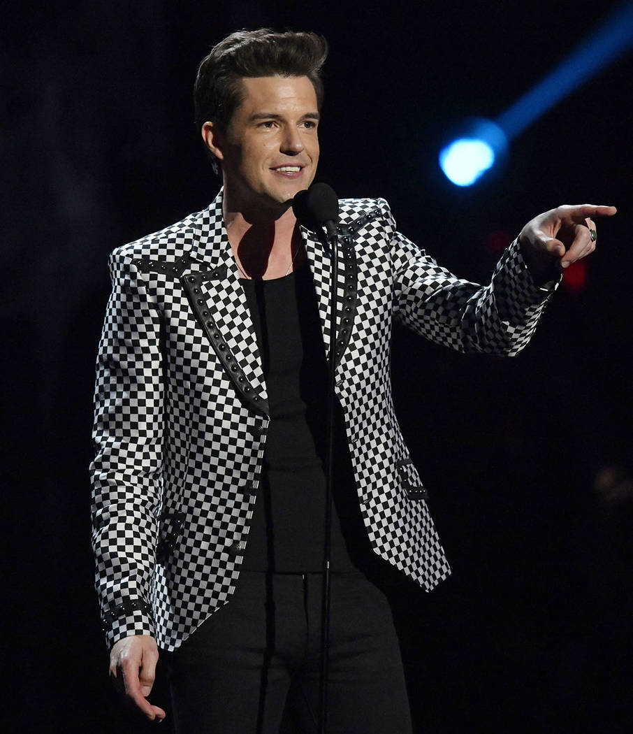 Brandon Flowers, from the band The Killers, speaks during the Rock and Roll Hall of Fame induction ceremony, Saturday, April 14, 2018, in Cleveland. (AP Photo/David Richard)