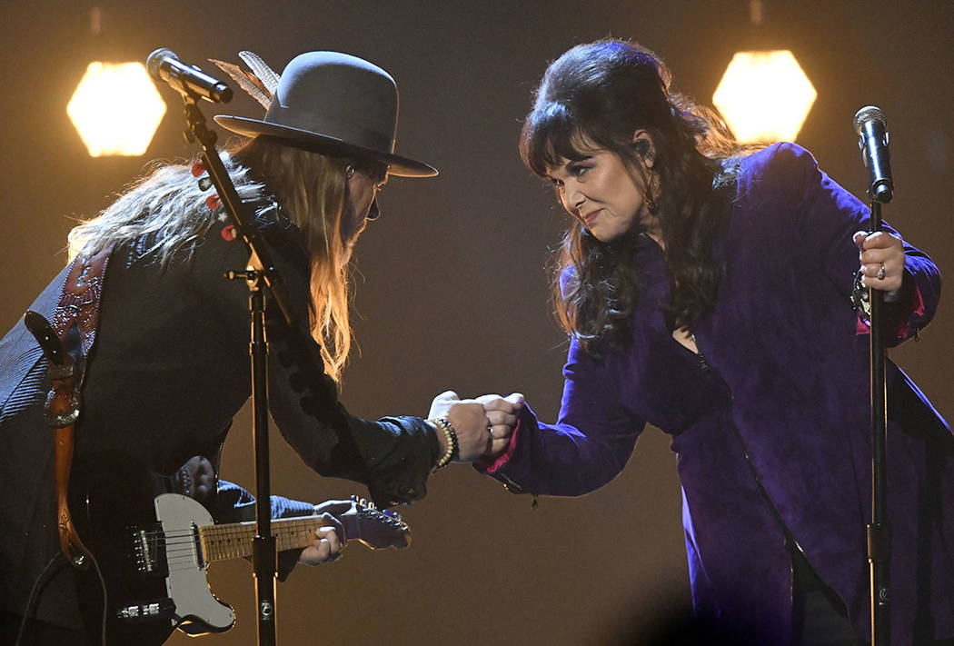 Jerry Cantrell, left, and Ann Wilson bump fists after performing during the Rock and Roll Hall of Fame Induction ceremony, Saturday, April 14, 2018, in Cleveland. (AP Photo/David Richard)