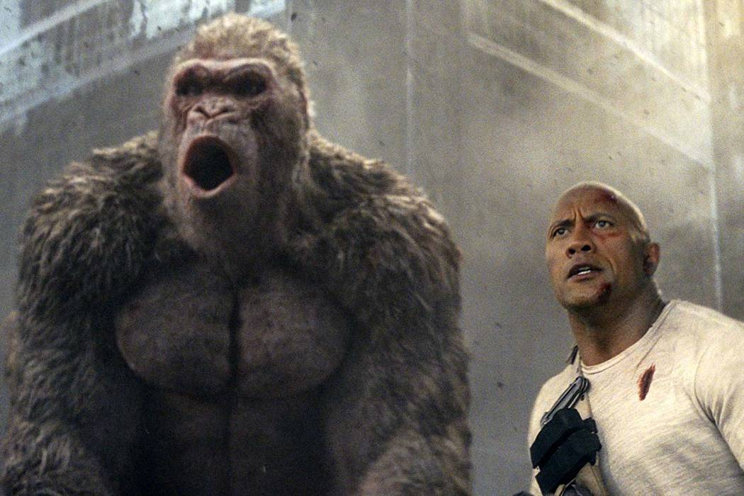 "This image released by Warner Bros. shows Dwayne Johnson in a scene from ""Rampage."" Johnson's arcade game-inspired ""Rampage"" crept past last week's top film ..."