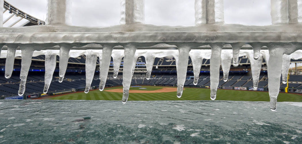 Ice forms on the railing above the fountains before a baseball game between the Kansas City Royals and Los Angeles Angels on Sunday, April 15, 2018, at Kauffman Stadium in Kansas City, Mo. (John S ...