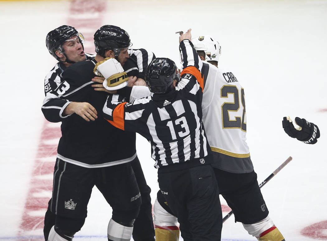 Golden Knights left wing William Carrier (28) gets into a fight with Los Angeles Kings left wing Kyle Clifford (13) during the first period of Game 3 of an NHL hockey first-round playoff series at ...