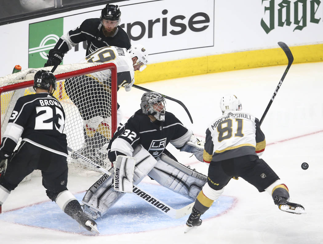 Los Angeles Kings goaltender Jonathan Quick (32) defends as Golden Knights center Jonathan Marchessault (81) watches the puck during the second period of Game 3 of an NHL hockey first-round playof ...