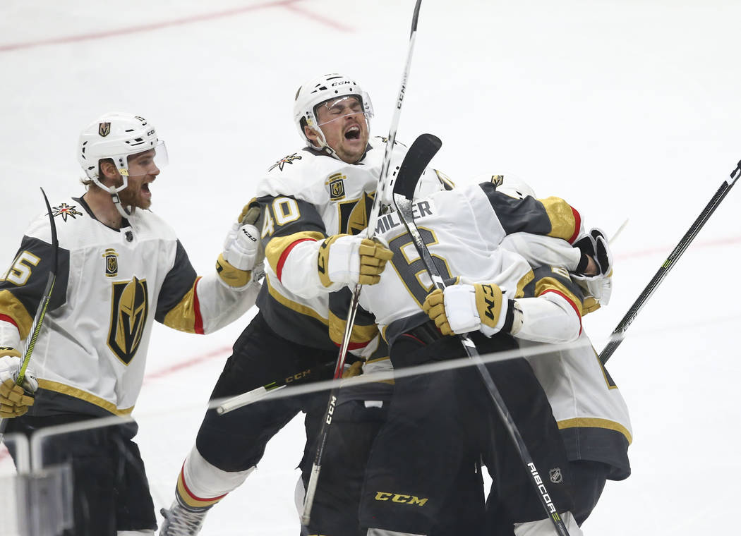 Golden Knights players including center Ryan Carpenter (40) and defenseman Jon Merrill (15) celebrate the goal by Golden Knights center Cody Eakin during the third period of Game 3 of an NHL hock ...