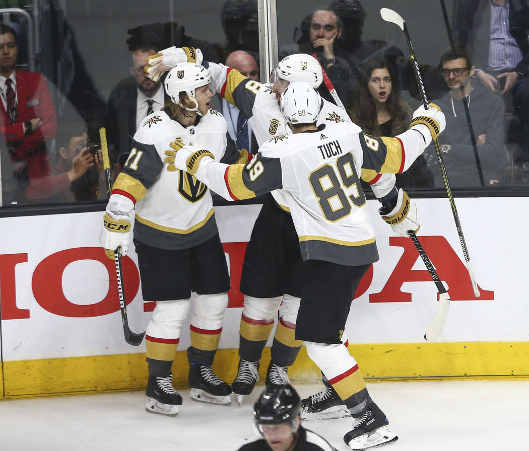 Golden Knights players celebrate a goal by left wing James Neal (18) during the third period of Game 3 of an NHL hockey first-round playoff series against the Los Angeles Kings at the Staples Cent ...