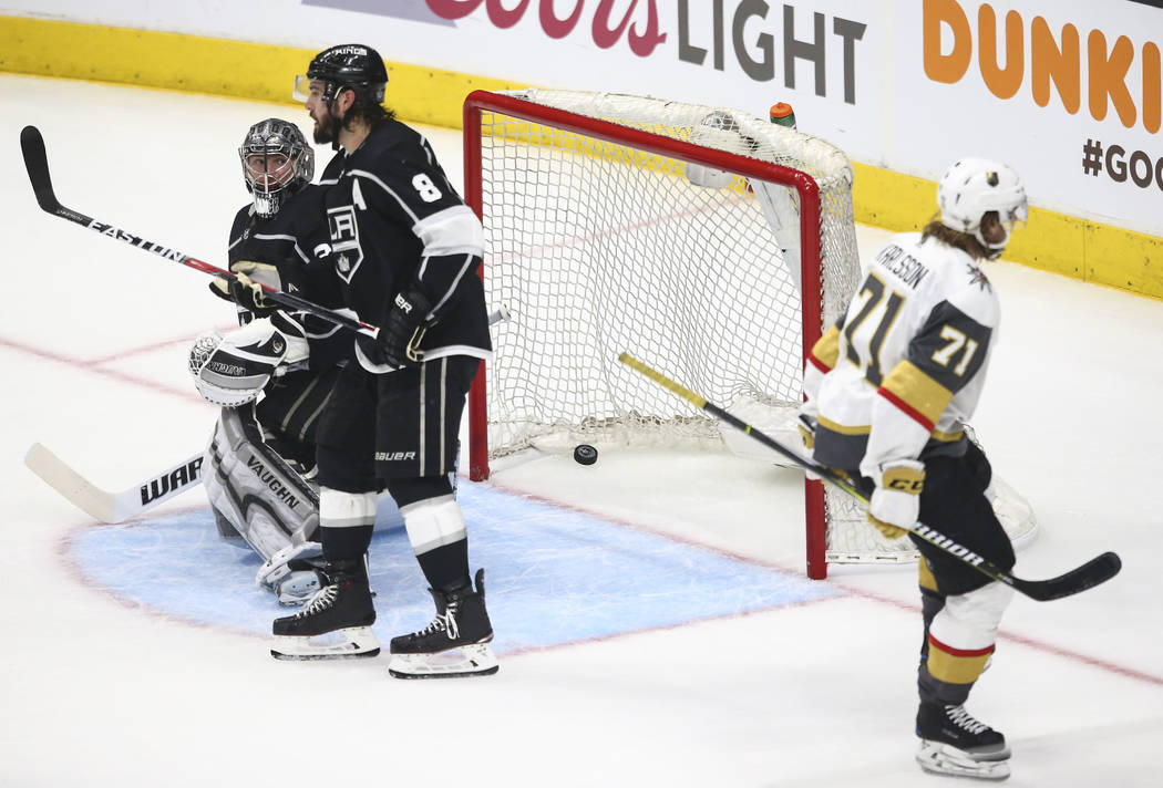Golden Knights center William Karlsson (71) scores a goal past Los Angeles Kings defenseman Drew Doughty (8) and goaltender Jonathan Quick (32) during the third period of Game 3 of an NHL hockey f ...
