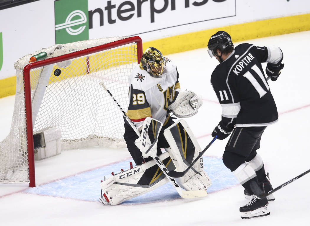 Los Angeles Kings center Anze Kopitar (11) scores a goal past Golden Knights goaltender Marc-Andre Fleury (29) during the third period of Game 3 of an NHL hockey first-round playoff series at the ...