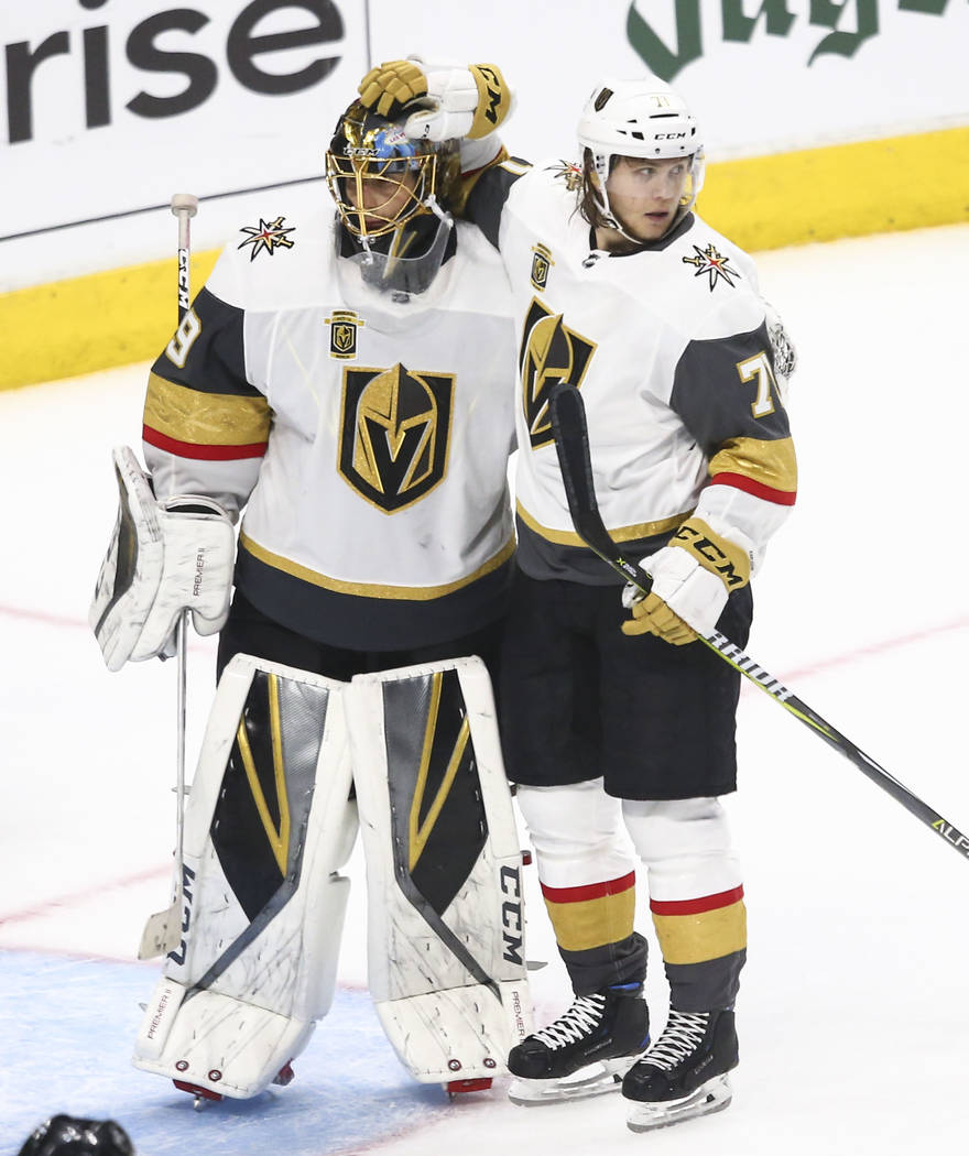 Golden Knights goaltender Marc-Andre Fleury (29) and Golden Knights center William Karlsson (71) celebrate their win over the Los Angeles Kings in Game 3 of an NHL hockey first-round playoff serie ...