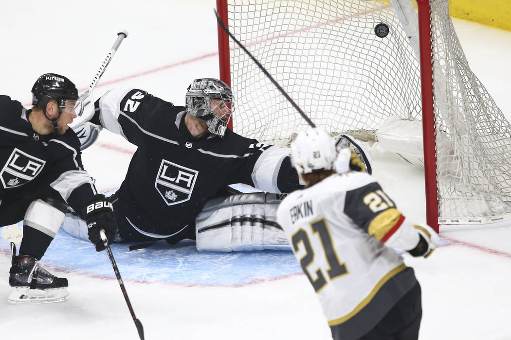 Golden Knights center Cody Eakin (21) scores a goal against Los Angeles Kings goaltender Jonathan Quick (32) during the third period of Game 3 of an NHL hockey first-round playoff series at the St ...