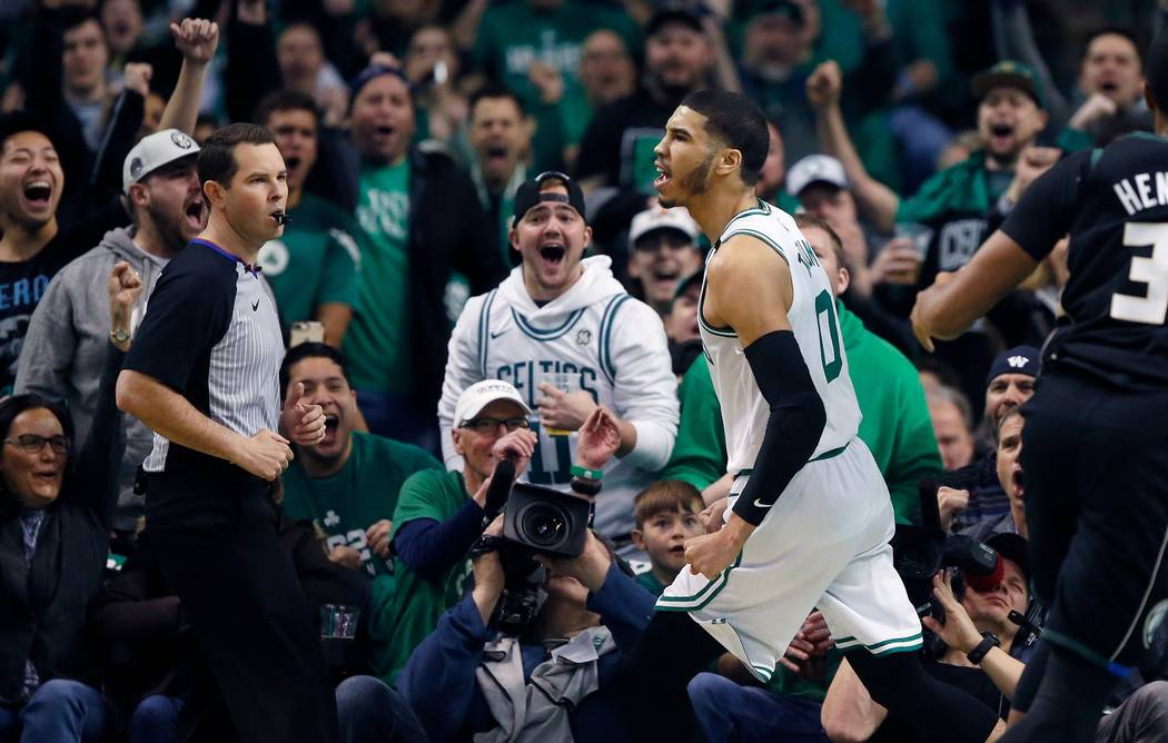 Boston Celtics' Jayson Tatum reacts after scoring during the first quarter of Game 1 of an NBA basketball first-round playoff series against the Milwaukee Bucks, in Boston, Sunday, April 15, 2018. ...