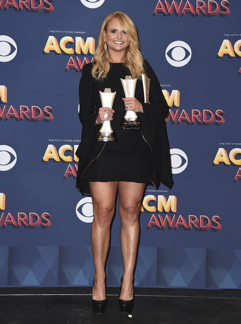 "Miranda Lambert poses in the press room with two awards for song of the year for ""Tin Man"" as performer and songwriter, and for female vocalist of the year at the 53rd annual Academy of ..."