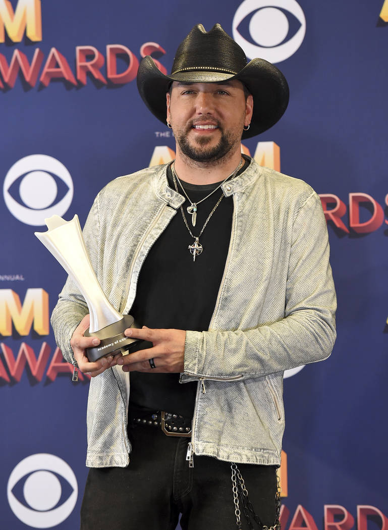 Jason Aldean poses in the press room with the award for entertainer of the year at the 53rd annual Academy of Country Music Awards at the MGM Grand Garden Arena on Sunday, April 15, 2018, in Las V ...