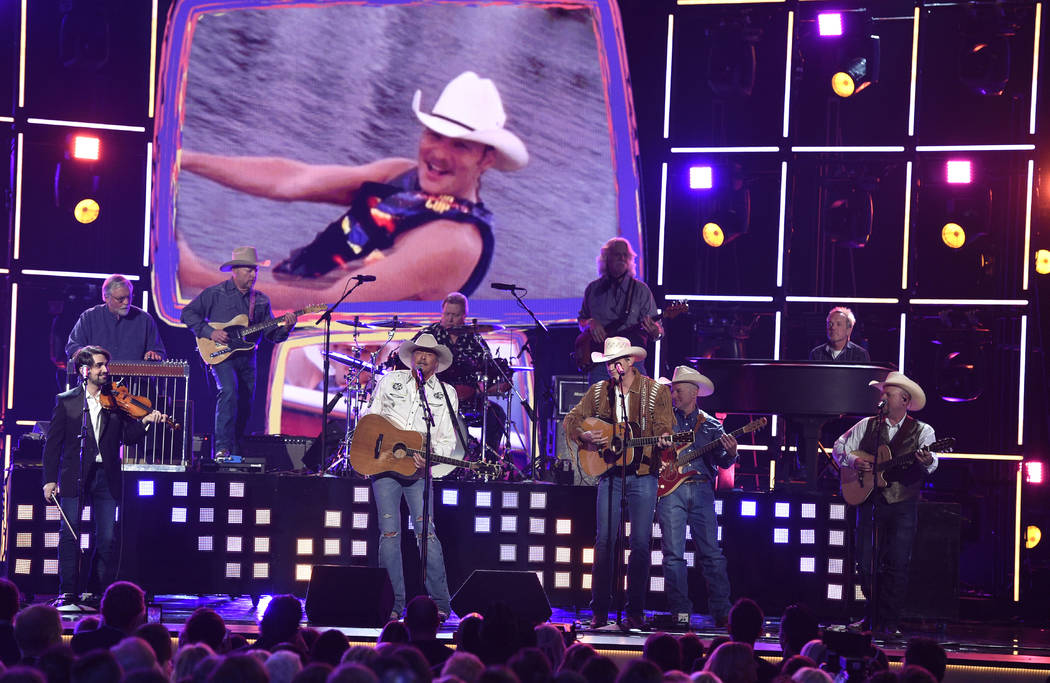 "Alan Jackson, left, and Jon Pardi perform ""Chattahoochee"" at the 53rd annual Academy of Country Music Awards at the MGM Grand Garden Arena on Sunday, April 15, 2018, in Las Vegas. (Photo ..."