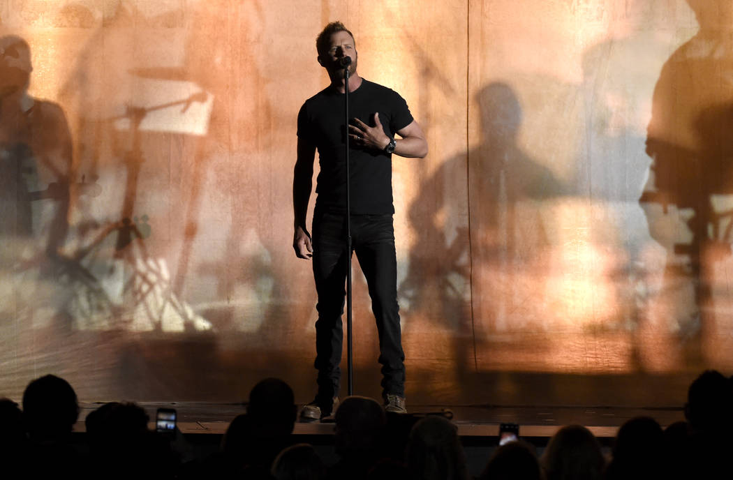 "Dierks Bentley performs ""Woman, Amen"" at the 53rd annual Academy of Country Music Awards at the MGM Grand Garden Arena on Sunday, April 15, 2018, in Las Vegas. (Photo by Chris Pizzello/I ..."