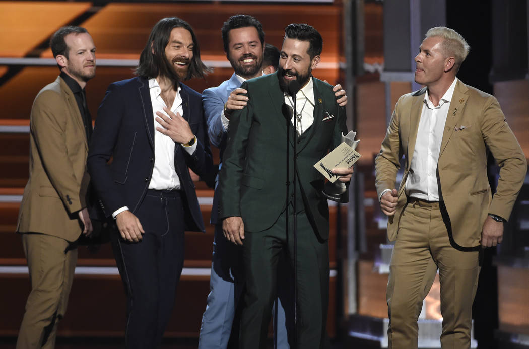 Whit Sellers, from left, Geoff Sprung, Brad Tursi, Matthew Ramsey and Trevor Rosen, of Old Dominion, accept the award for vocal group of the year at the 53rd annual Academy of Country Music Awards ...