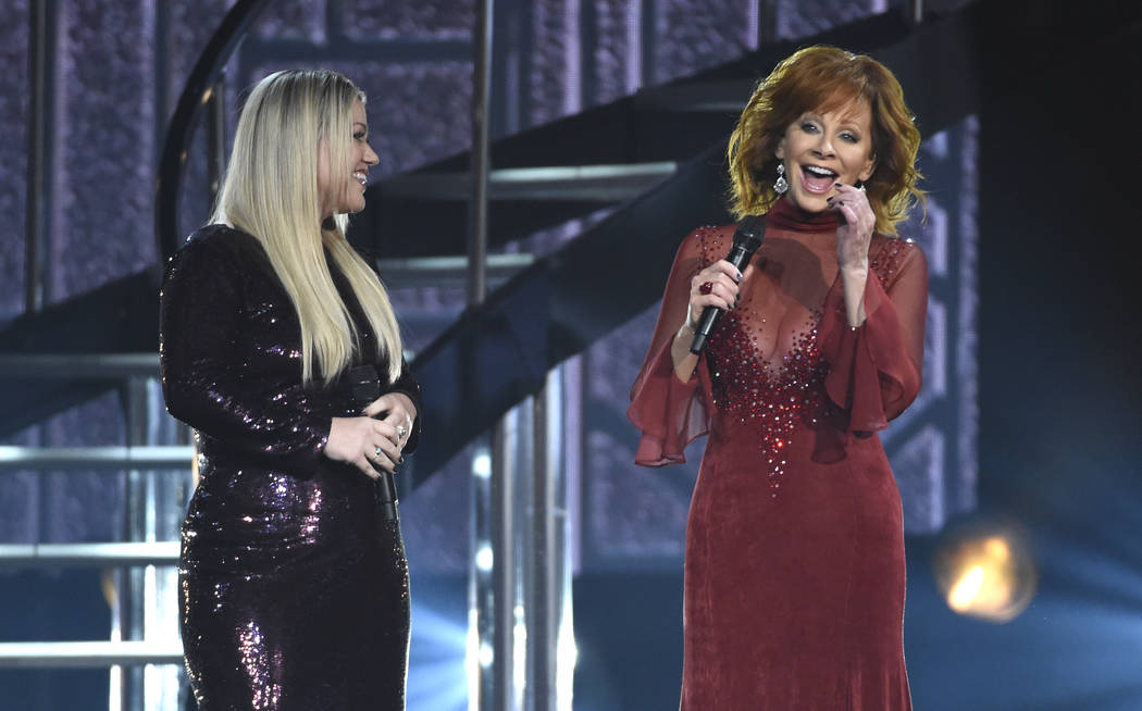 "Kelly Clarkson, left, and Reba McEntire perform ""Does He Love You"" at the 53rd annual Academy of Country Music Awards at the MGM Grand Garden Arena on Sunday, April 15, 2018, in Las Vega ..."