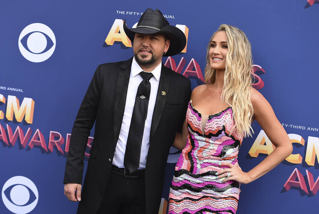 Jason Aldean, left, and Brittany Kerr arrive at the 53rd annual Academy of Country Music Awards at the MGM Grand Garden Arena on Sunday, April 15, 2018, in Las Vegas. (Photo by Jordan Strauss/Invi ...