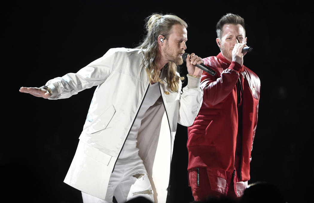 "Tyler Hubbard, right, and Brian Kelley, of Florida Georgia Line, perform ""Meant to Be"" at the 53rd annual Academy of Country Music Awards at the MGM Grand Garden Arena on Sunday, April 1 ..."