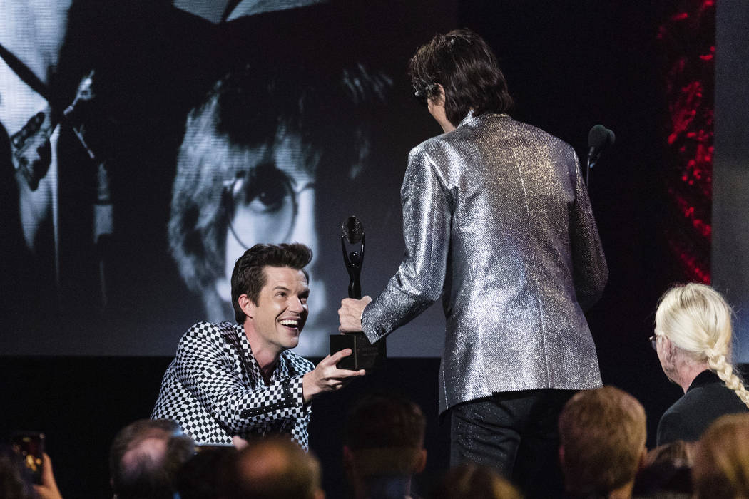 Brandon Flowers, left, and Ric Ocasek are seen at the 2018 Rock and Roll Hall of Fame Induction Ceremony at Cleveland Public Auditorium Saturday, April 14, 2018, in Cleveland, Ohio. (Photo by Mich ...