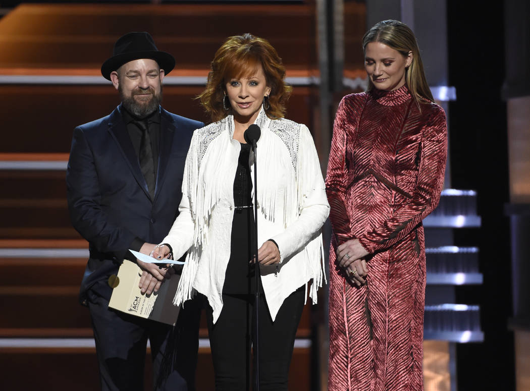 """Reba McEntire, center, accepts the award for album of the year for """"From A Room: Volume 1"""" on behalf of Chris Stapleton at the 53rd annual Academy of Country Music Awards at the MGM Gran ..."""