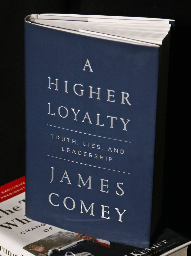 "A copy of former FBI Director James Comey's new book, ""A Higher Loyalty: Truth, Lies and Leadership,"" is on display, Friday, April 13, 2018, in New York. (AP Photo/Bebeto Matthews)"